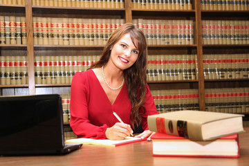 Young attractive female professional, women in workplace, female lawyer in law office
