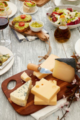 Cheese assortments on cutting board