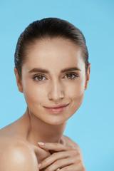 Face Skin Beauty. Portrait Of Beautiful Woman With Natural Makeu