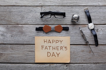 Happy Fathers Day card on rustic wood background