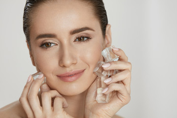 Skin Beauty Care. Woman Using Ice For Face Spa Treatment