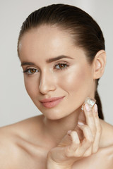 Ice On Skin. Woman Doing Face Skin Treatment
