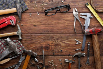 Frame of repair tools on wood background with copy space