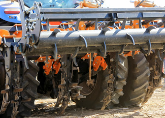 Details of a modern combine harvester close-up. modern combine harvester works in the field. Sowing and harvesting.
