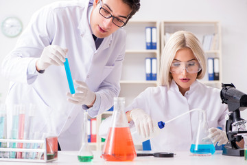 Two chemists having discussion in lab