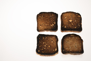 Burned bread with seeds isolated on white background