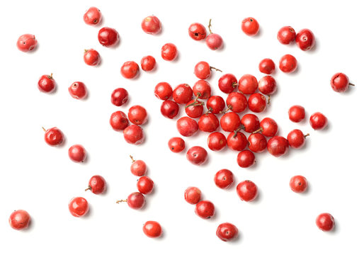 dried pink peppercorns isolated on white, top view