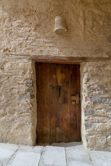 Ancient stone bricks wall and old wooden door at the Monastery of Saint Paul the Anchorite (aka Monastery of the Tigers), Egypt