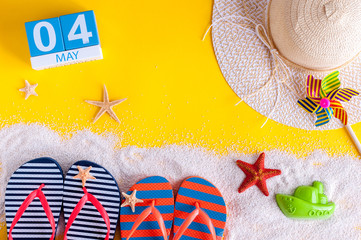 May 4th. Image of may 4 calendar with summer beach accessories. Spring like Summer vacation concept