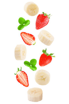 Falling banana and strawberry isolated on white