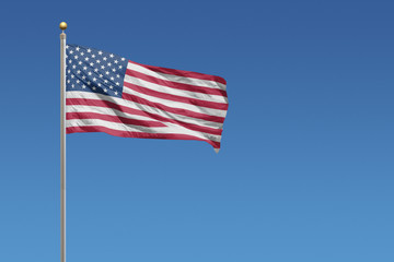 USA Flag of in front of a clear blue sky