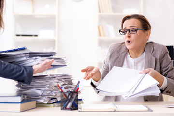 Businesswoman very busy with ongoing paperwork