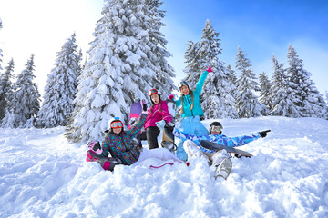 Friends at snowy ski resort. Winter vacation