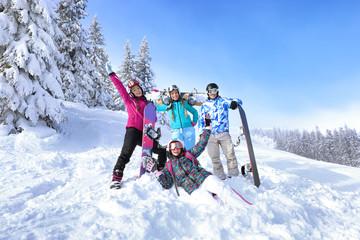 Friends at snowy ski resort. Winter vacation Wall mural
