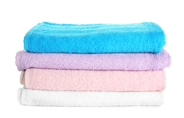 Stack of clean towels on white background. Laundry day