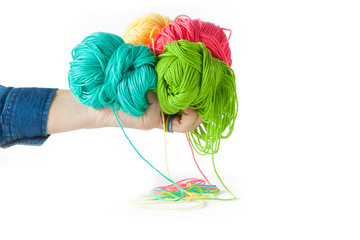 A female hand holds cotton yarn for knitting
