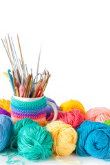 Yarn balls for knitting and hooks, knitting needles.