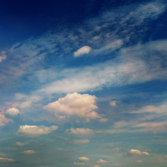 Background from the dramatic sky with clouds in blue tones.