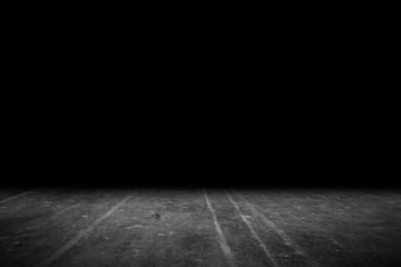 Texture dark concrete floor on black background