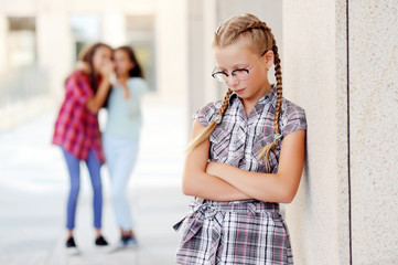Schoolgirl suffering from bullying in the school