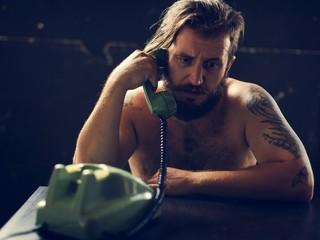 Man using telephone on tension talking