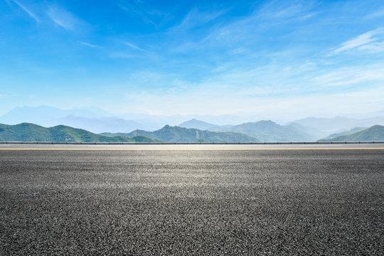 asphalt highway and hill landscape under the blue sky