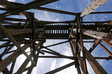 Looking up at old obsolete railroad bridge in Arizona, USA