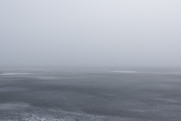 MIST OVER FROZEN SEA