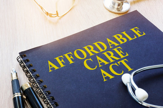 Affordable Care Act ACA and stethoscope on a table.