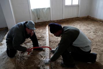 Reisch uses a saw as he works in Hosszuheteny