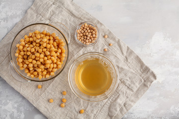 Chickpea broth - aquafaba. Replace egg in baking for vegan recipe, top view, copy space. Healthy diet concept.
