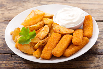 plate of fish sticks with fried potatoes
