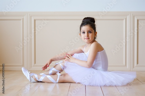 little girl ballerina in white tutu stock photo and royalty free