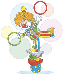 Circus show of a comic juggler - equilibrist. Friendly smiling clown balancing on several objects and juggling with hoops, a vector illustration in a cartoon style