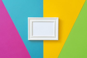 white photo frame on a colored background