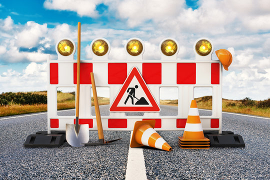 Baustelle, Absperrung, Straßensperrung mit Schaufel, Pickel, Baustellenschild, Pylone und Sicherheitshelm auf Straße