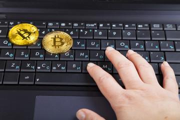 Female hand  and bitcoins