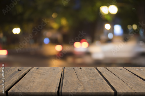 Empty wooden table of brown on front blurred night light