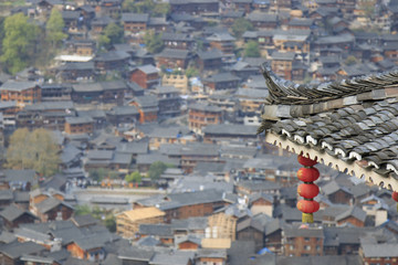 Chinese lantern on foreground and Xijiang Qianhu Miao Village in Guizhou, China on background
