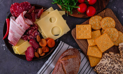 Meat and cheese plate.Traditional italian antipasto, cutting board with salami, cold smoked meat,...