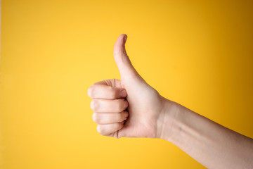 emale hand showing thumbs up gesture
