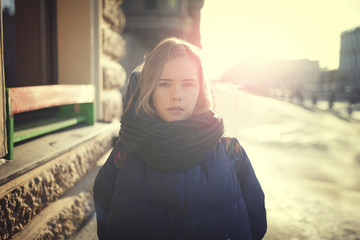 girl on a Sunny winter day on the street