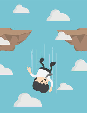 Businessman falling down from cliff or high mountain