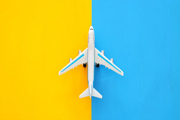top view photo of toy airplanover double colorful background. Concept of imagination, creativity, dreaming and childhood.
