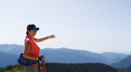 Image of female tourist showing hand into distance