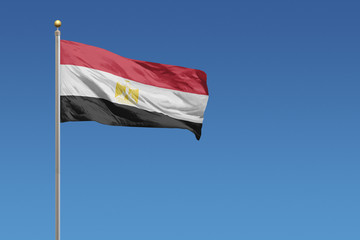 Flag of Egypt in front of a clear blue sky