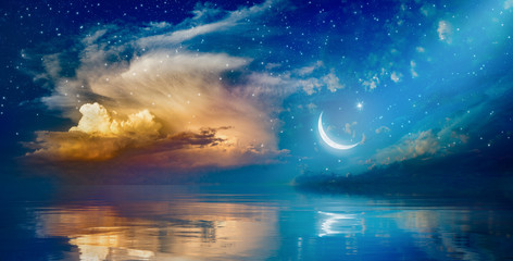 Ramadan Kareem background with crescent, stars and glowing clouds Wall mural