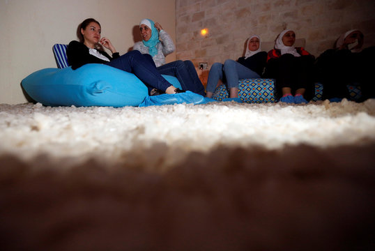 A group sits in the salt cave before a meditation session in Amman