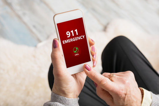 Old person dialing emergency number 911 on phone