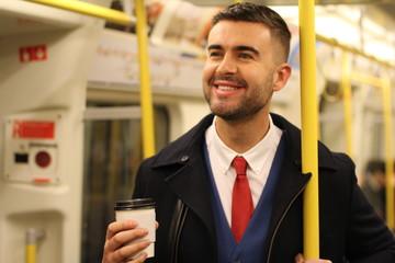 Cheerful businessman using public transportation
